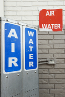 Signs advertising air and water pumps