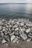 Rocks piled along shore