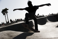 Young man skateboarding in skate park