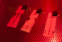 Chemical test strips illuminated by red light