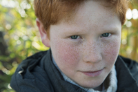 Boy with red hair and freckles, portrait