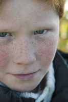 Boy with sulky expression, portrait