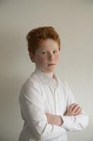 Boy with arms folded, portrait