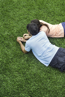 Couple lying together on grass