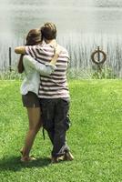 Young couple enjoying weekend holiday at lake