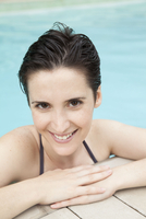 Woman relaxing in pool, portrait