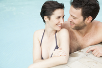 Couple relaxing together in pool