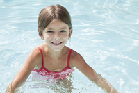 Girl swimming in pool, portrait