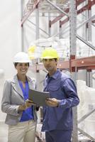 Engineers in warehouse, portrait