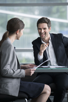Businessman man having lighthearted meeting with client