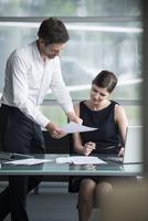 Businessman explaining document to colleague