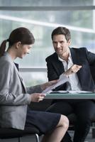 Businessman explaining document to client