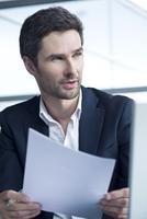 Businessman holding document