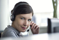 Receptionist using telephone headset