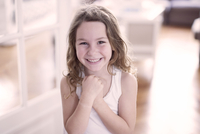 Little girl smiling cheerfully, portrait