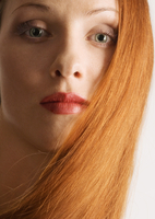 Woman with red hair, wearing lipstick, portrait