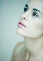 Woman looking up, portrait