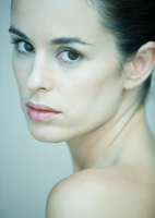 Woman looking over shoulder, portrait