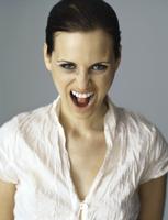 Woman shouting at camera, portrait