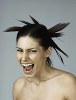 Woman with spiky hairdo, mouth wide open
