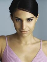 Woman staring at camera, smiling, portrait