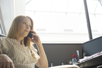 Office worker making phone call at desk