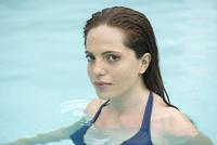 Woman relaxing in pool, portrait