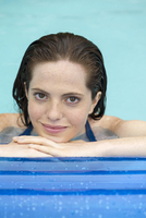 Woman relaxing on float in swimming pool