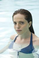 Woman in swimming pool, portrait