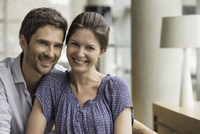 Couple smiling together at home, portrait