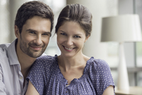 Couple relaxing together at home, portrait