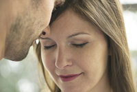 Couple nuzzling, close-up