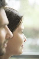 Woman gazing out window, profile