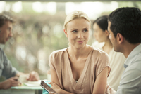 Woman smiling at male colleague during casual meeting