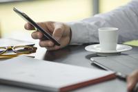 Coffee break, using smartphone