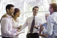 Colleagues having laugh together in office