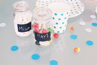 Jars of candy and party accessories
