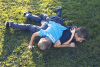 Young brothers playing together on lawn