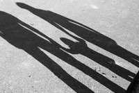 Shadow of parents and child holding hands