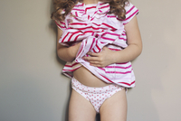 Little girl in underwear, cropped