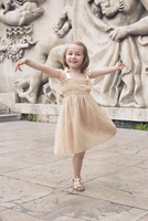 Little girl dancing outdoors