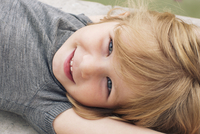 Little girl lying on her back, smiling, portrait