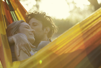 Affectionate couple relaxing together in hammock