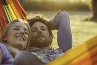 Couple relaxing together in hammock, portrait