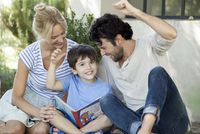 Parents teaching child to read