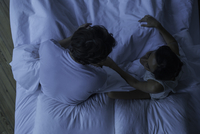 Couple being intimate in bed together