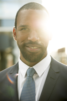 Businessman backlit by sun, portrait