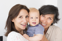 Smiling grandmother, mother and baby, portrait