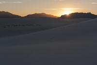 Sunset over dunes at White Sands National Monument, New Mexico, USA
