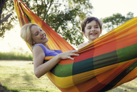Mother and son relaxing together in hammock